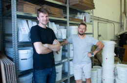 Jaroslav and Ondre at the Candycano Coffee Roastery (shelfs with coffee)
