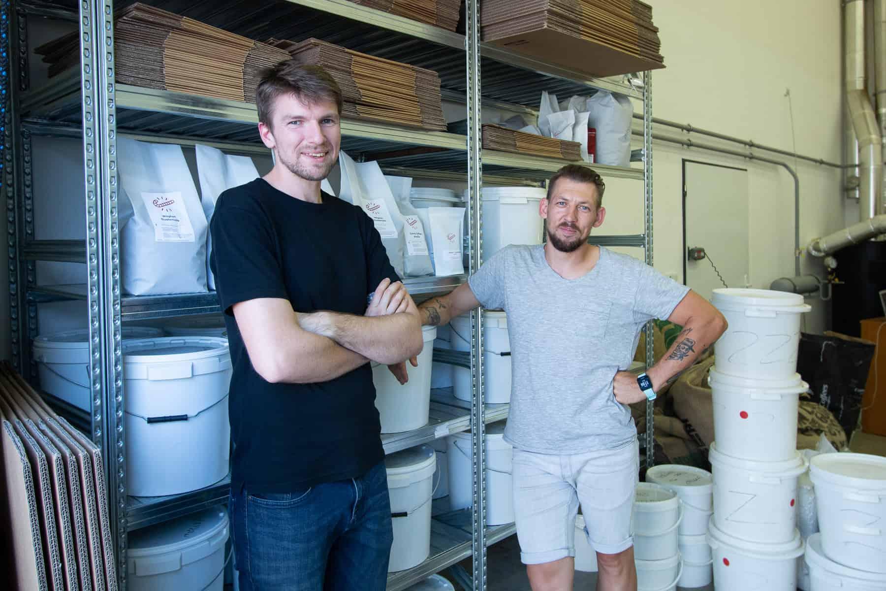 Jaroslav and Ondre at the Candycano Coffee Roastery (shelfs with coffee)